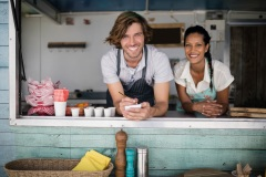 Portrait of waiter and waitress smiling